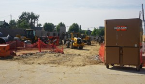 Across the street from the Twin 9s site, construction is underway on a large apartment complex.