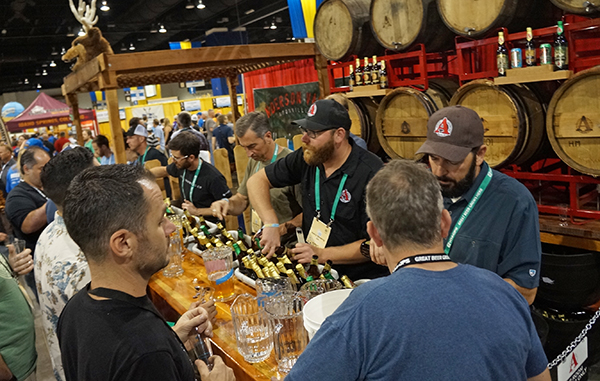 The Avery Brewing Co. pours out sample beers at GABF. Photo by Amy DiPierro.