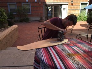 Tommy works on a deck cutout. Photo courtesy of Lowtide.
