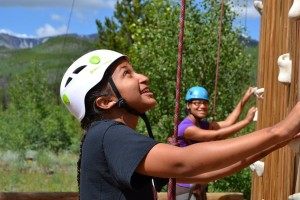 An ELK student learns the ropes of climbing at a 2014 event.