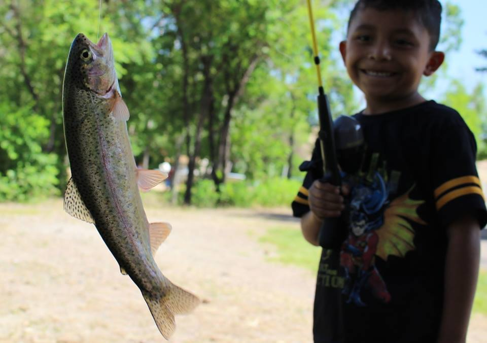 An ELK student shows off his catch at a fishing clinic. Photos courtesy of ELK.