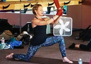 Rebecca Kirschner teaching an Aireal Yoga Class class.