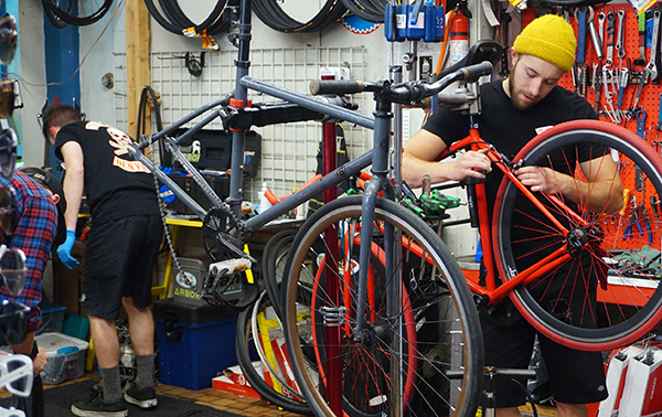A bike technician inside Edgeworks. Photo by Burl Rolett.
