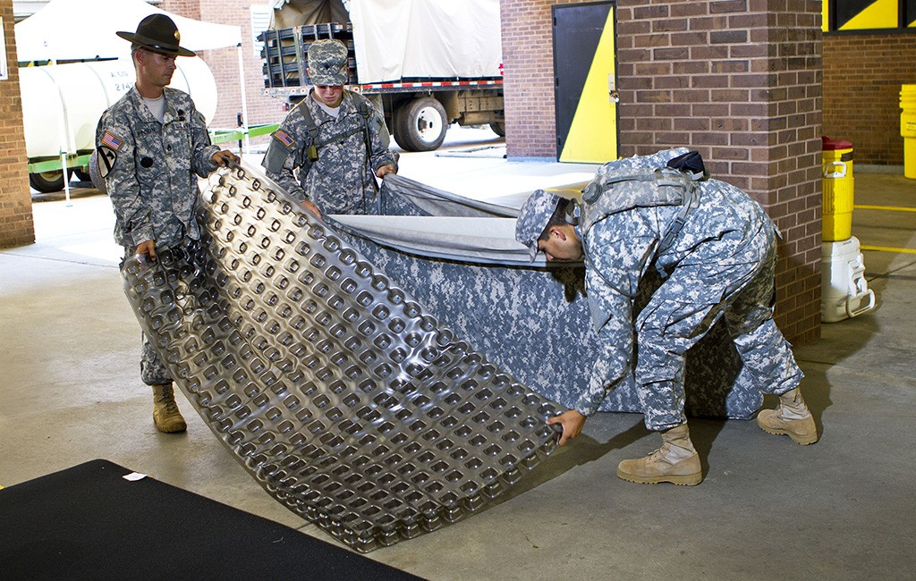 Military members reassemble a Skydex mattress. (Courtesy Skydex)